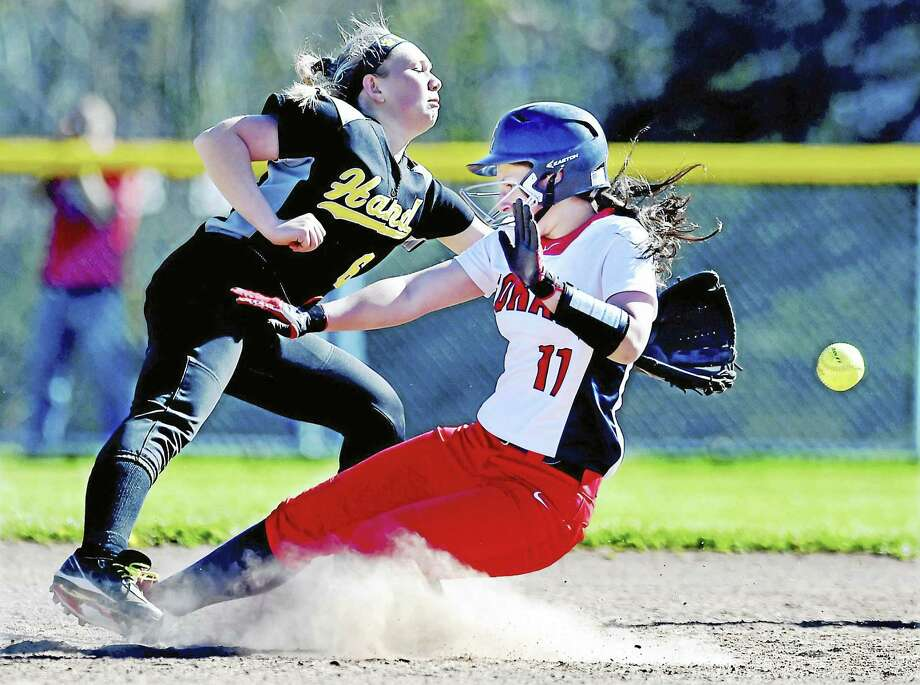 Hand senior Samantha Pavano reaches for the ball as Foran sophomore outfielder Alyssa Deptulski steals second Wednesday in a 11-8 win for the Lions at Foran High School in Milford. Photo: Catherine Avalone — New Haven Register   / New Haven RegisterThe Middletown Press