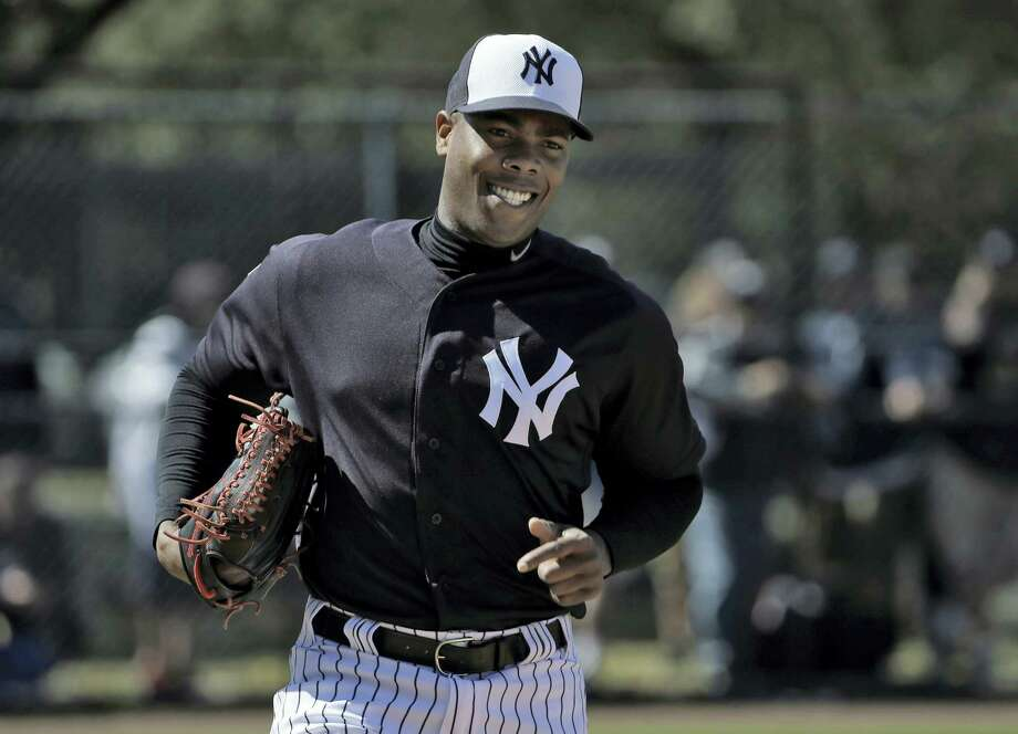 Yankees pitcher Aroldis Chapman smiles as he runs pickoff drills during a workout earlier this spring. Photo: The Associated Press File Photo   / AP