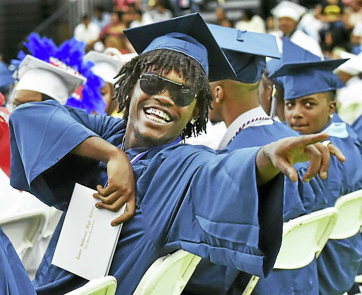 Daquan Dangerfield makes eye contact with his family after receiving his diploma at James Hillhouse High School commencement Thursday in New Haven.