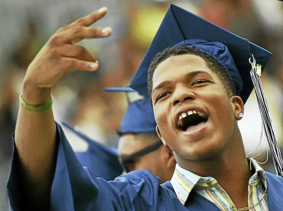 Andre Wooten shouts out to his family at James Hillhouse High School class of 2016 commencement exercises Thursday at the Floyd Little Athletic Center in New Haven.