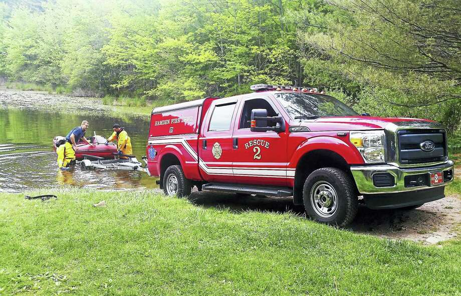 Hamden firefighters helped state and local police search part of West Rock Ridge State Park Thursday morning after a hiker reported seeing an overturned kayak in Lake Wintergreen. Photo: Courtesy Of Hamden Fire Department