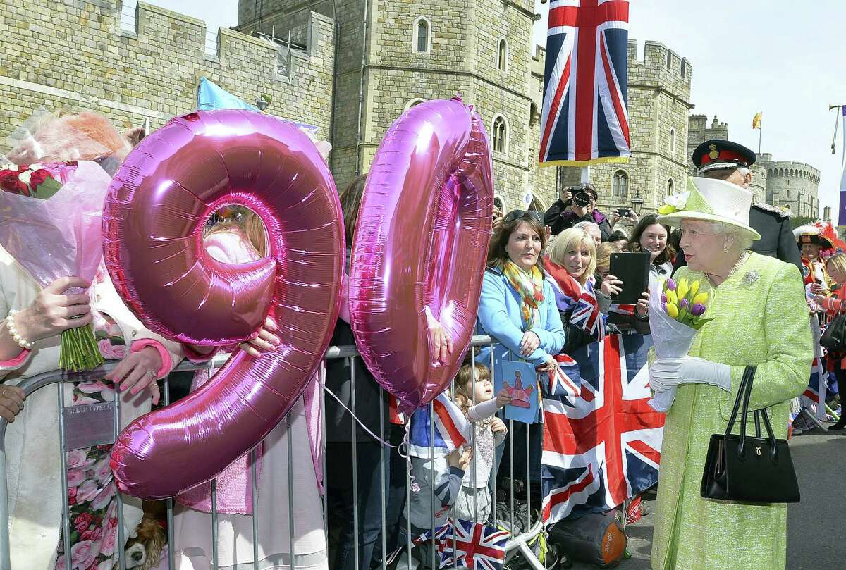John Stillwell/PA via AP Britain's Queen Elizabeth II meets well-wishers during a walkabout close to Windsor Castle in Berkshire as she celebrates her 90th birthday Thursday April 21, 2016.