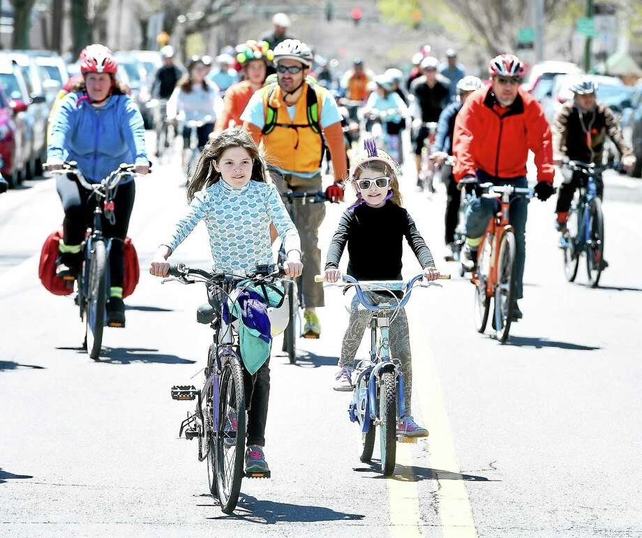 (Arnold Gold-New Haven Register) Riders finish the 8 mile ride in the 7th Annual Rock to Rock Earth Day Ride at East Rock Park in New Haven on 4/25/2015.  Over 1,200 riders participated raising over $175,000. Photo: Journal Register Co.