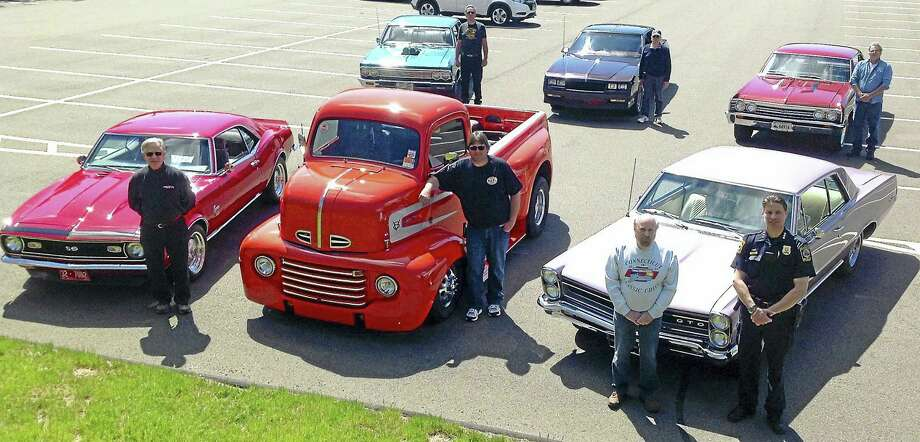Hundreds of classic and antique cars and their owners will descend on the campus of Quinnipiac University May 29 for the 22nd annual Connecticut Classic Chevy Club car show. Among the owners and their cars are, front row, from left: Louis Tagliatela with his 1968 Camaro; Jody Wilk, 1948 Ford pickup COE; George Civitelli, 1965 Pontiac GTO; and Hamden Police Chief Thomas Wydra, whose department helps sponsor the show. Back row, from left: Will Fleming, 1966 Chevelle; Bob Civitelli, 1986 Monte Carlo SS; and Jim Mauro, 1967 Chevelle SS. Photo: CONTRIBUTED PHOTO
