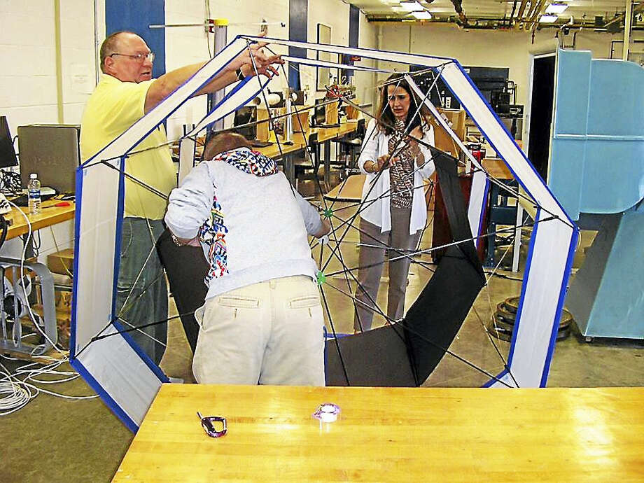 UNH students Gary Engvall and Jeff Planko with professor Jean Nocitio Globel work on a carousel kite. Photo: Contributed Photo