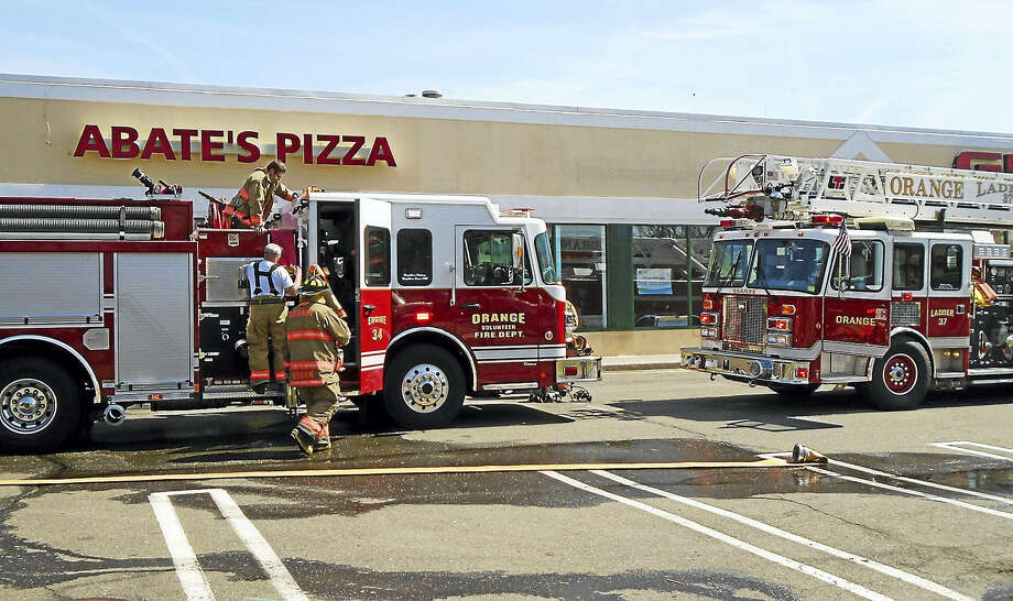 A kitchen fire Thursday morning did extensive damage inside Abate's Pizza in Orange. Firefighters were able to knock down the flames quickly, but a fire marshal said the restaurant will be closed for some time for repairs. Photo: Wes Duplantier — New Haven Register   / Copyright 2009