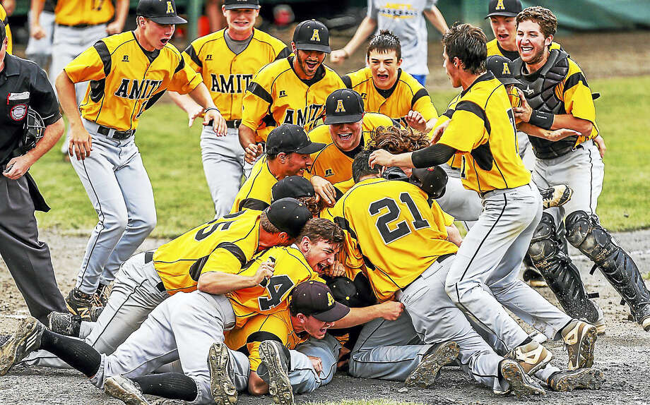 The Amity High School Spartans defeated the Fairfield-Warde Mustangs 4-3 for the CIAC Class LL Baseball crown this past weekend. Photo: Photo By John Vanacore/Register