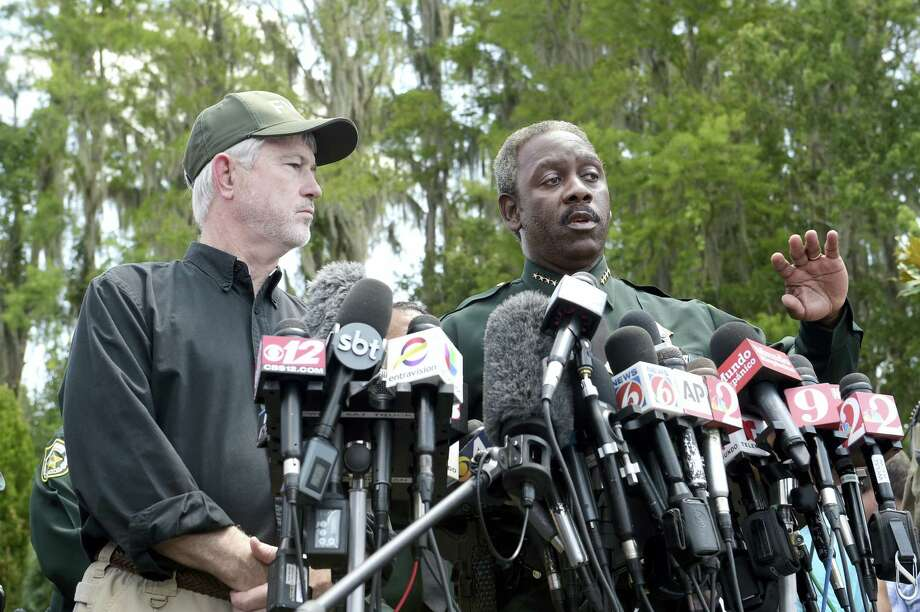 Nick Wiley, executive director of the Florida Fish & Wildlife Conservation Commission, left, and Orange County Sheriff Jerry Demings answer questions from reporters during a news conference Wednesday, June 15, 2016, in Lake Buena Vista, Fla., after a toddler was dragged into the lake Tuesday eveningby an alligator outside Disney's Grand Floridian Resort & Spa. Photo: AP Photo — Phelan M. Ebenhack / FR121174 AP