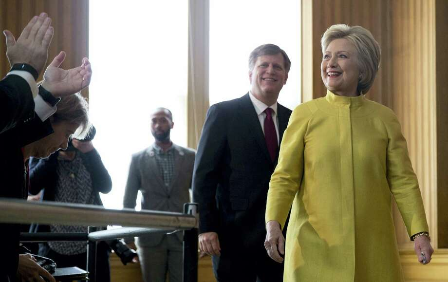 Democratic presidential candidate Hillary Clinton arrives with former United States Ambassador to Russia Michael McFaul to speak about counterterrorism at the Bechtel Conference Center at Stanford University on Wednesday. Photo: The Associated Press   / AP