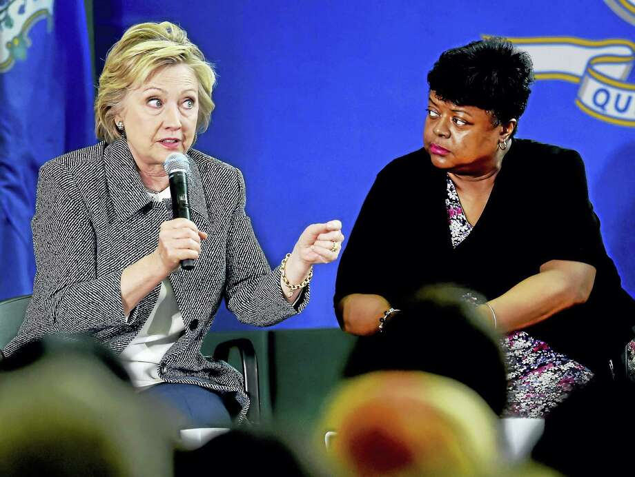 Democratic Presidential candidate Hillary Clinton, left, with Kimberly Washington of New Haven as Clinton makes a stop at the Wilson-Gray YMCA in Hartford, Connecticut Thursday, April 21, 2016 to participate in panel discussion on gun violence prevention with family members of gun violence victims. Photo: Peter Hvizdak — New Haven Register   / ?2016 Peter Hvizdak