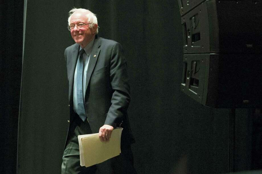 Democratic presidential candidate, Sen. Bernie Sanders, I-Vt., walks onto the stage during a campaign stop, Thursday in Scranton, Penn. Photo: Christopher Dolan — The Times & Tribune Via AP / The Scranton Times-Tribune