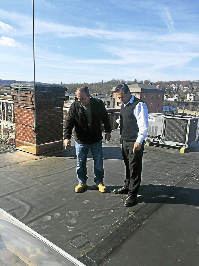 Public Works Director Mike D'Alessio, left, and Mayor David Cassetti recently inspect new roof over Ansonia City Hall. Photo: Contributed Photo