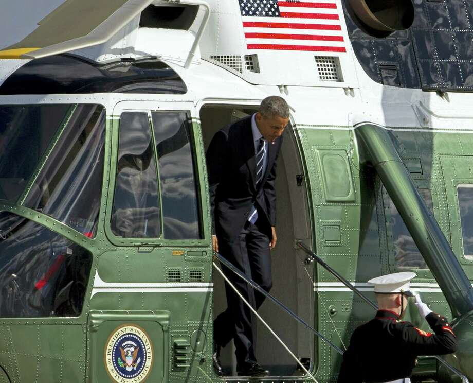 President Barack Obama steps off Marine One upon his arrival at Andrews Air Force Base in Maryland Friday. Photo: THE ASSOCIATED PRESS   / FR159526 AP
