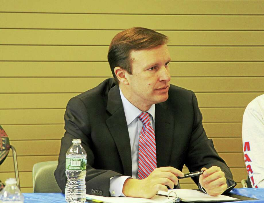 U.S. Sen. Chris Murphy, D-Conn., hears from environmental advocates about the dangers of high nitrogen levels in Long Island Sound and suggestions on how to combat the problem in Connecticut at a roundtable discussion Thursday at the Sound School in New Haven. Photo: Anna Bisaro — New Haven Register