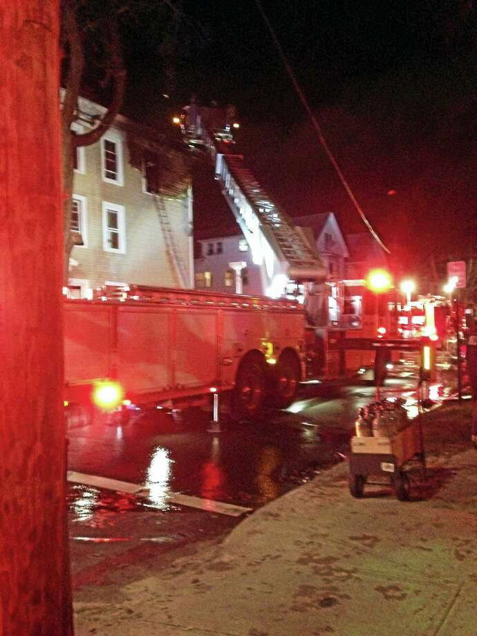 12 were displaced by a two-alarm fire Thursday night at 127 James St. in Fair Haven. Photo: Ed Stannard — New Haven Register