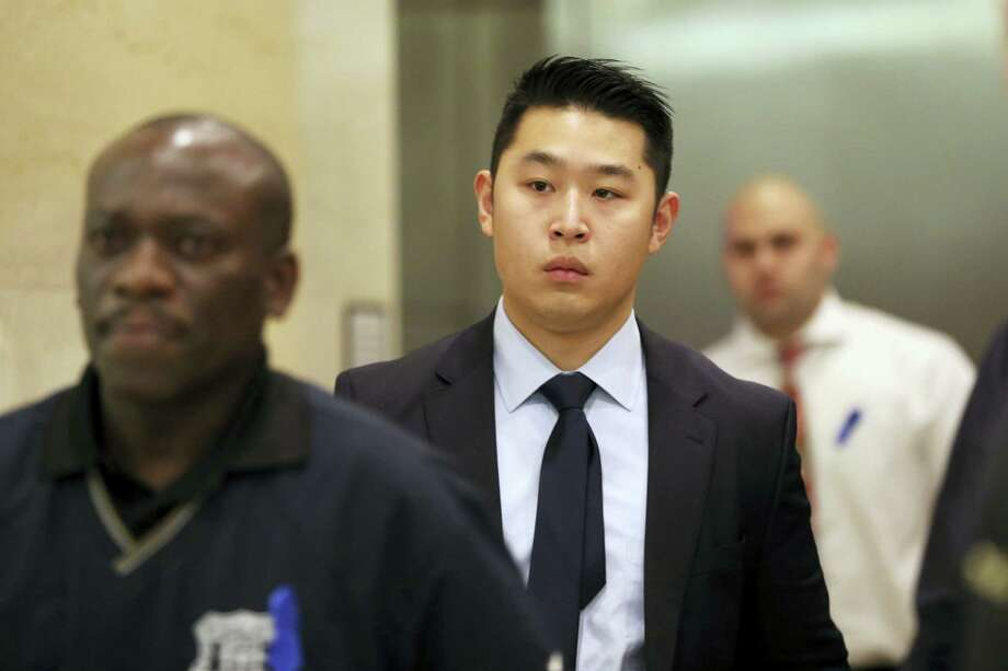 In a Feb. 9 photo, former police officer Peter Liang, center, exits the courtroom during a break in closing arguments in his trial on charges in the shooting death of Akai Gurley, at Brooklyn Supreme court in New York. Photo: Mary Altaffer — The Associated Press   / AP