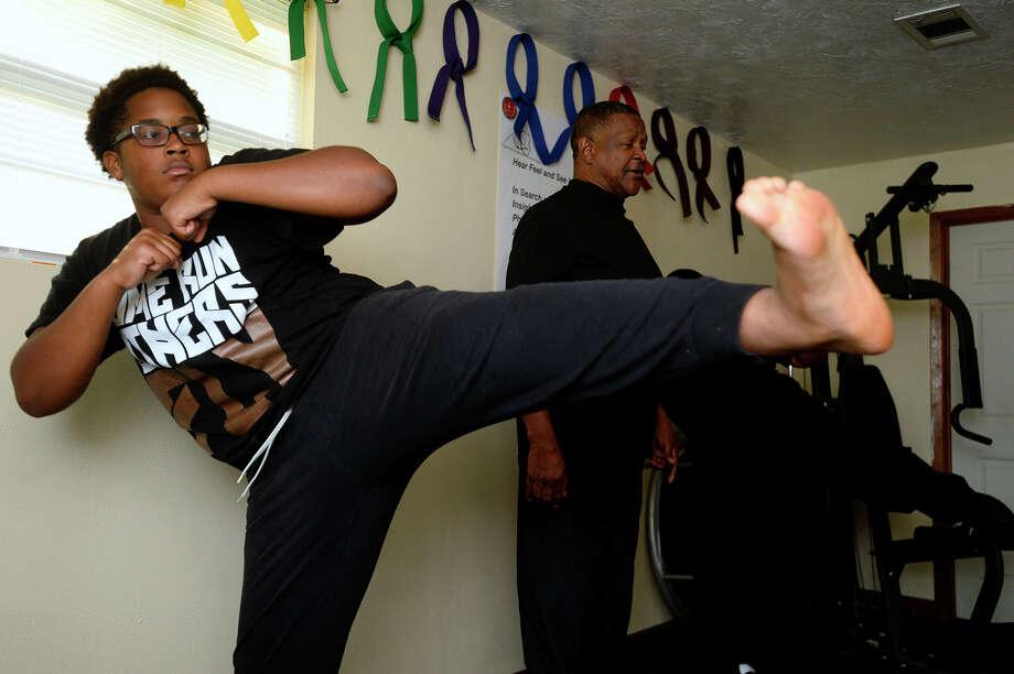 Jaden Seastrunk, 15, practices kicks at Reggie Boseman's home karate studio on Thursday evening.  Photo taken Thursday 7/20/17 Ryan Pelham/The Enterprise Photo: Ryan Pelham / ©2017 The Beaumont Enterprise/Ryan Pelham