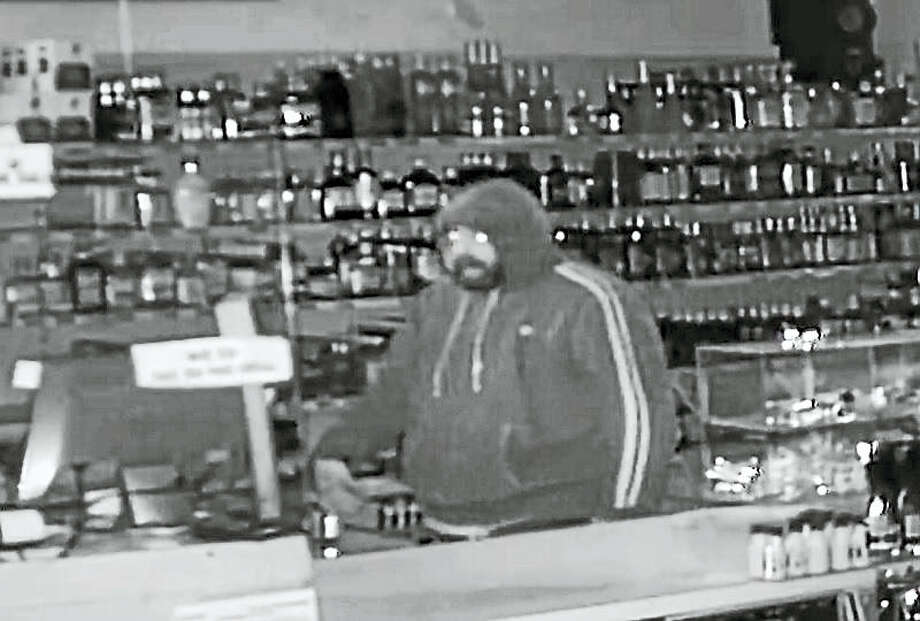 Police are asking for the public's help to identify this man who they say stole approximately $200 from the cash register at Party Time Package Store in Ansonia. Photo: ANSONIA POLICE DEPARTMENT