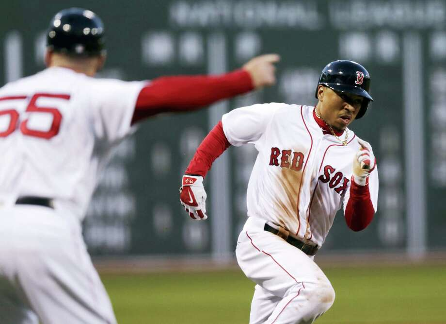 Mookie Betts rounds third during Wednesday's game in Boston. Photo: Charles Krupa — The Associated Press   / AP