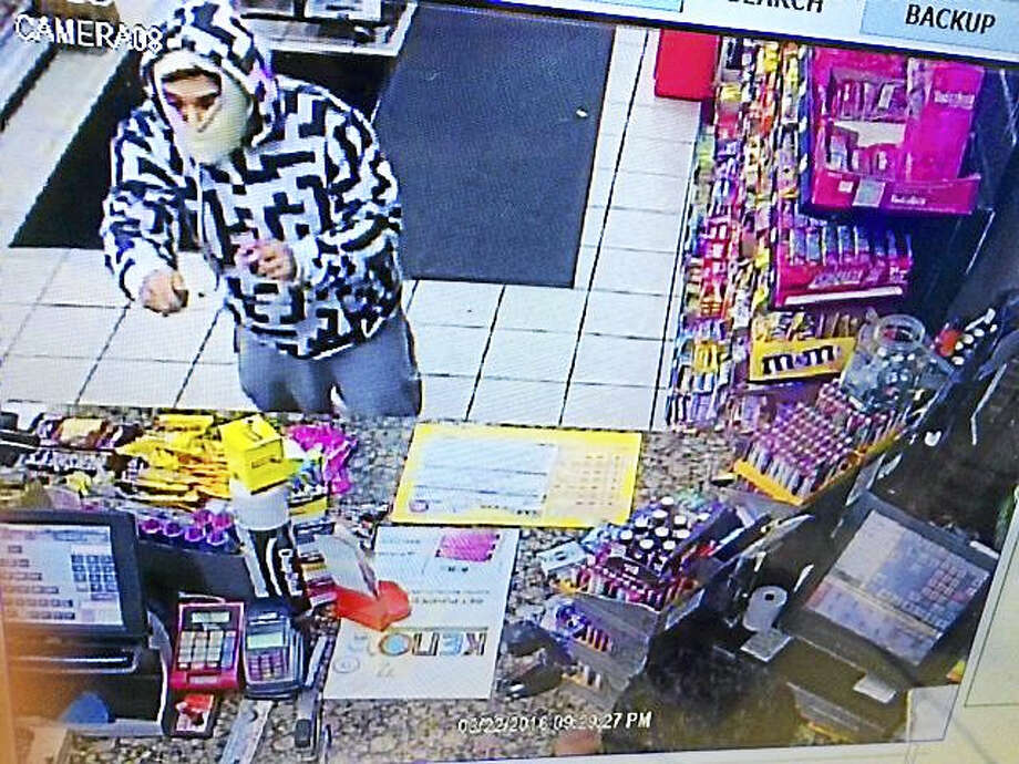 Police are asking the public to help them find this man, who allegedly robbed a Shell gas station Tuesday night while wearing a distinctive sweatshirt. Photo: Courtesy Of Ansonia Police Department