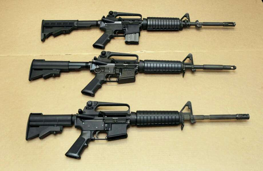 Three variations of the AR-15 rifle are displayed at the California Department of Justice in Sacramento. Omar Mateen used an AR-15 that he purchased legally when he killed 49 people in an Orlando nightclub over the weekend. Photo: THE ASSOCIATED PRESS   / Copyright 2016 The Associated Press. All rights reserved. This material may not be published, broadcast, rewritten or redistribu