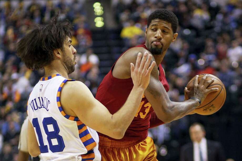 Indiana Pacers forward Paul George (13) looks to pass around New York Knicks guard Sasha Vujacic (18) during the second half Wednesday. Photo: The Associated Press   / FR123854 AP