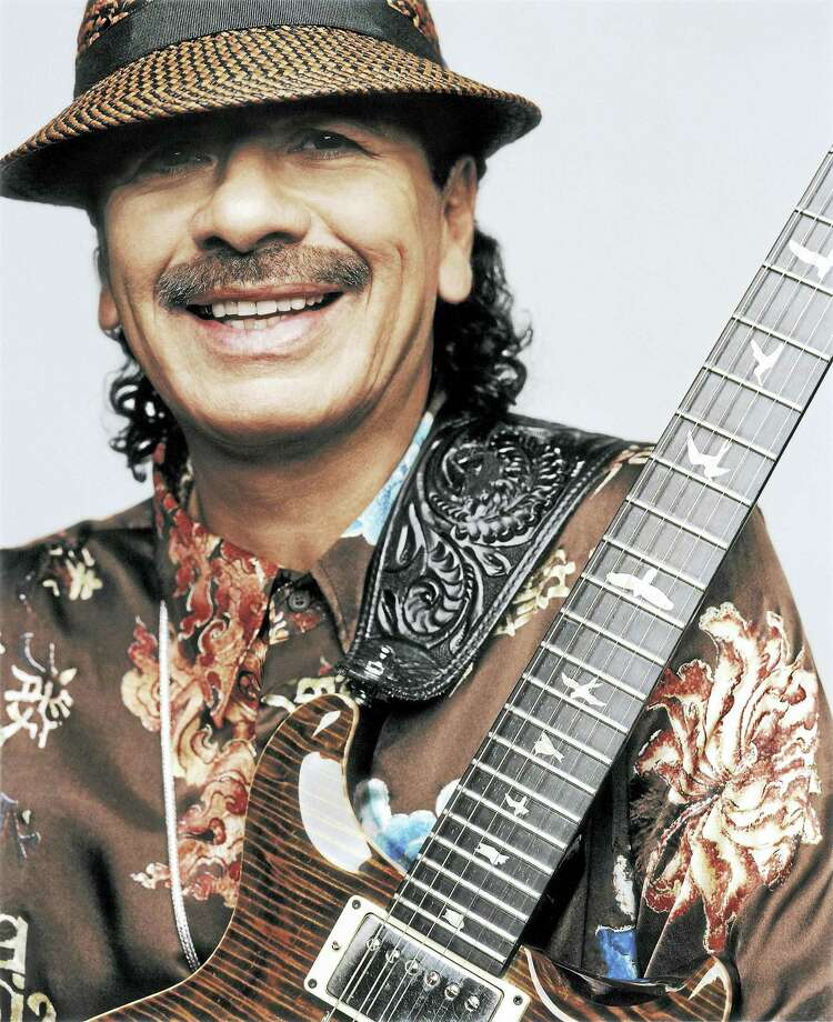 Carlos Santana and his band, Santana, will perform at Mohegan Sun Arena along with Journey on April 15. Photo: Contributed