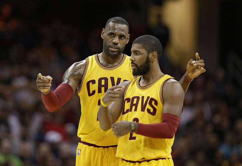 In Cleveland, Kyrie Irving's camp is mad at LeBron James' camp  because Kyrie's camp believes LeBron's camp leaked word that Kyrie asked  to be traded. Photo: Tony Dejak, Associated Press