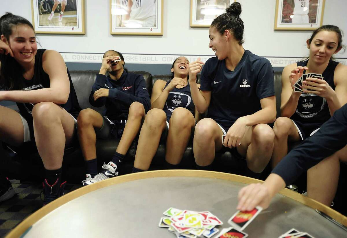 Walk-on Briana Pulido, far right, seen here playing cards with teammates Kia Nurse, second from right, Moriah Jefferson, second from left, and Gabby Williams, center, with Natalie Butler looking on last March, stays busy with her pursuit of medical school.