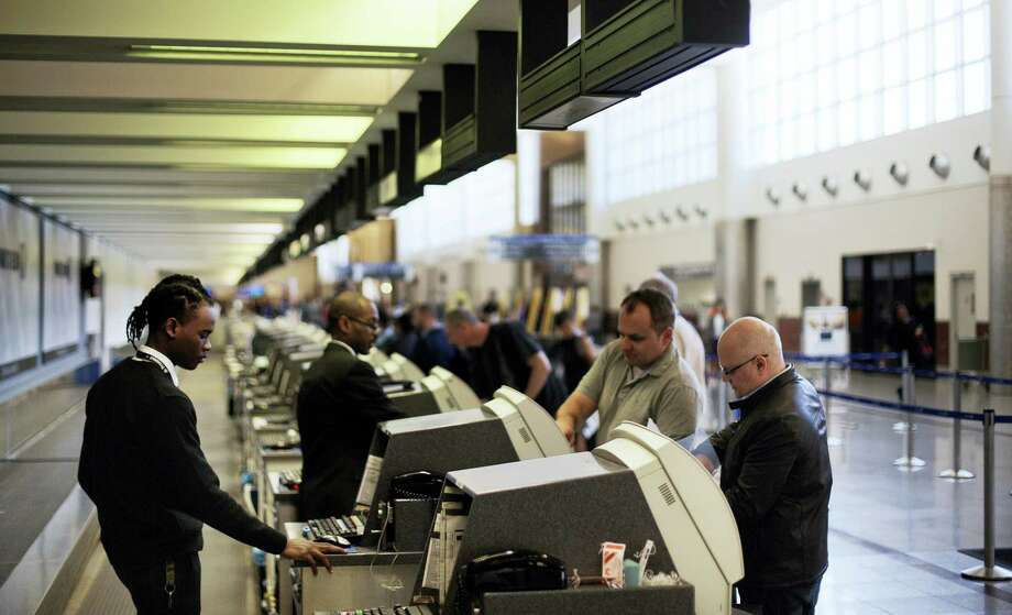 In this March 10, 2016, file photo, passengers check-in at the North terminal of the domestic passenger terminal at Hartsfield-Jackson Atlanta International Airport in Atlanta.  Officials at Hartsfield-Jackson Atlanta International Airport this month said they were moving toward allowing Uber and other ride-sharing services, a reversal of a ban on such services from curbside pickup. Photo: AP Photo/David Goldman    / AP