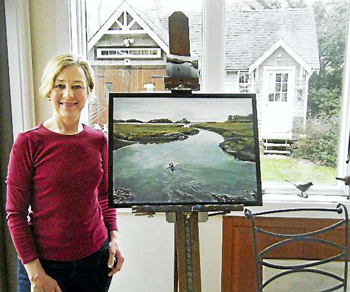 Branford artist Nancy Rusatsky with her painting.