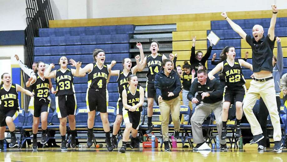 Daniel Hand High School celebrates Wednesday after defeating Mercy High School of Middletown during the SCC girls basketball championship at East Haven High School. Photo: Peter Hvizdak — The New Haven Register   / ?2016 Peter Hvizdak