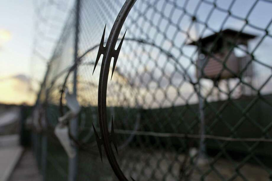 "In this May 13, 2009, file photo, reviewed by the U.S. military, the sun rises over the Guantanamo detention facility at dawn, at the Guantanamo Bay U.S. Naval Base, Cuba.  In the last comprehensive review of prisoners held at Guantanamo Bay, the U.S. government decided nearly 50 were ""too dangerous to transfer but not feasible for prosecution,"" leaving them in an open-ended legal limbo. Photo: AP Photo/Brennan Linsley, File    / AP"