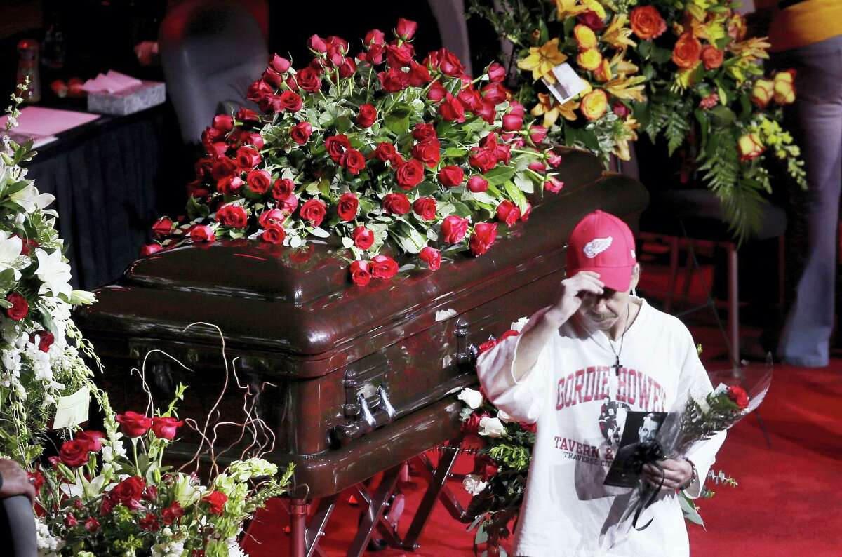 A fan walks away after paying his respect to Gordie Howe, the man known as Mr. Hockey, at Joe Louis Arena, the home of the Detroit Red Wings, his team for much of his NHL Hall of Fame career.