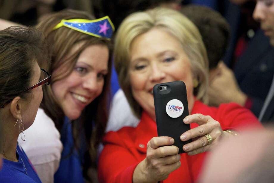 Democratic presidential candidate Hillary Clinton takes a photo with a member of the audience after speaking at a rally at Washington High School in Cedar Rapids, Iowa on Jan. 30, 2016. Photo: AP Photo/Andrew Harnik   / AP