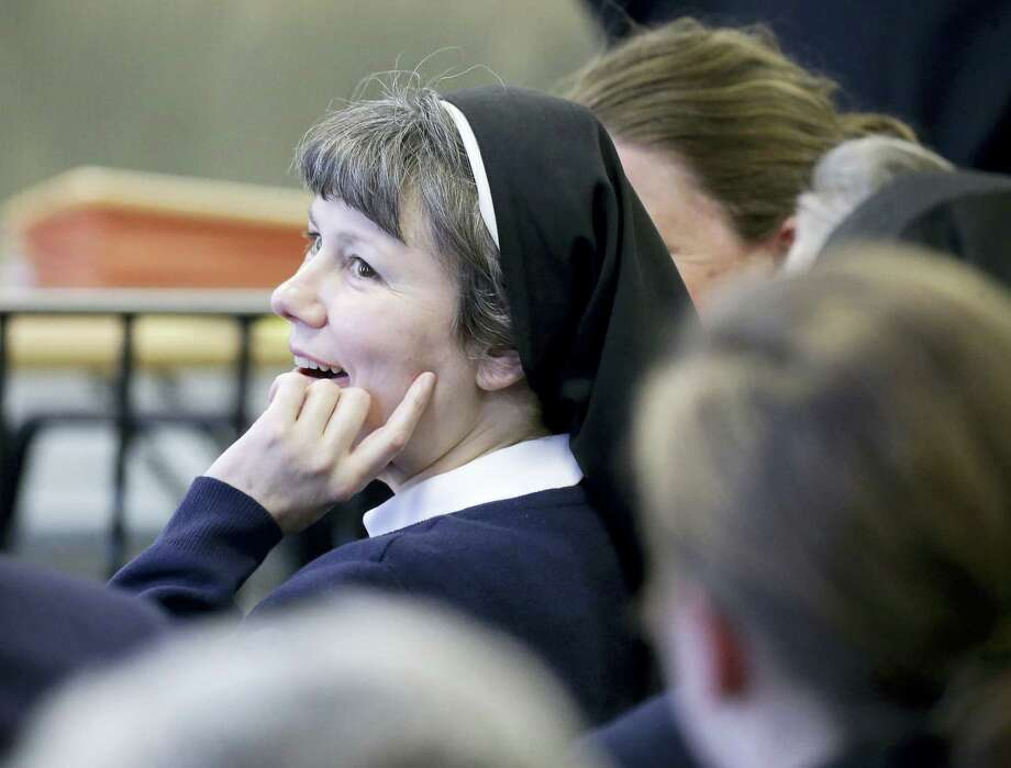 In a Wednesday, April 13, 2016 file photo, Sister Kimberly Miller, a Philadelphia nun and teacher at Little Flower High School for Girls in the city, looks on before appearing in Washington Township Municipal Court, in Washington Township, N.J. Miller was convicted Wednesday, April 20, 2016, of drunken driving charges despite her assertion that she had a sedative and doesn't remember crashing her car into a New Jersey building. Photo: Tim Hawk — NJ.com Via AP, Pool, File / Pool South Jersey Times NJ.com