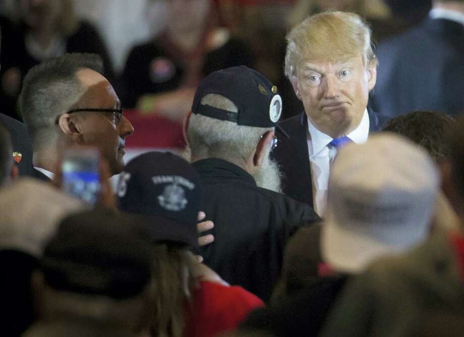 Republican presidential candidate Donald Trump makes his way through the crowd during a campaign stop at the Savannah Center last week in West Chester, Ohio. Photo: File Photo   / AP