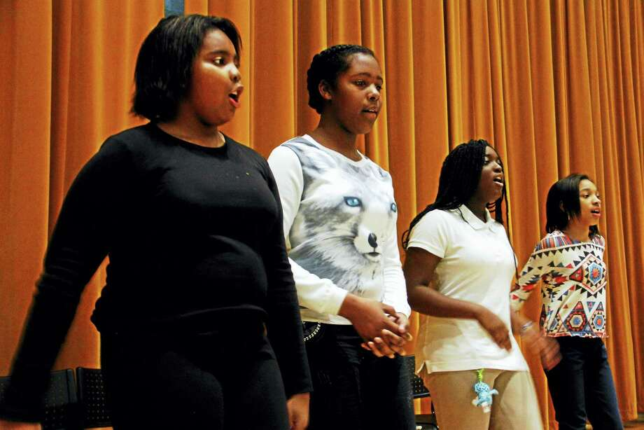 From left: Niara McMillan, Na'Tori Ward, Shakeira Bell and Beyonce Jones rehearse before a performance celebrating Black History Month at Augusta Lewis Troup School in New Haven. Photo: Esteban L. Hernandez — New Haven Register