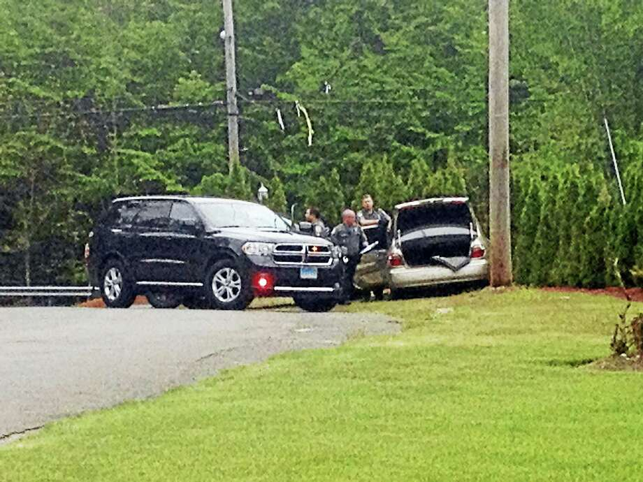A suspect who led police on a chase up a dead-end street in Orange on Tuesday afternoon then crashed into a supervisor's SUV, police said. Photo: Will Ruddell — For The New Haven Register
