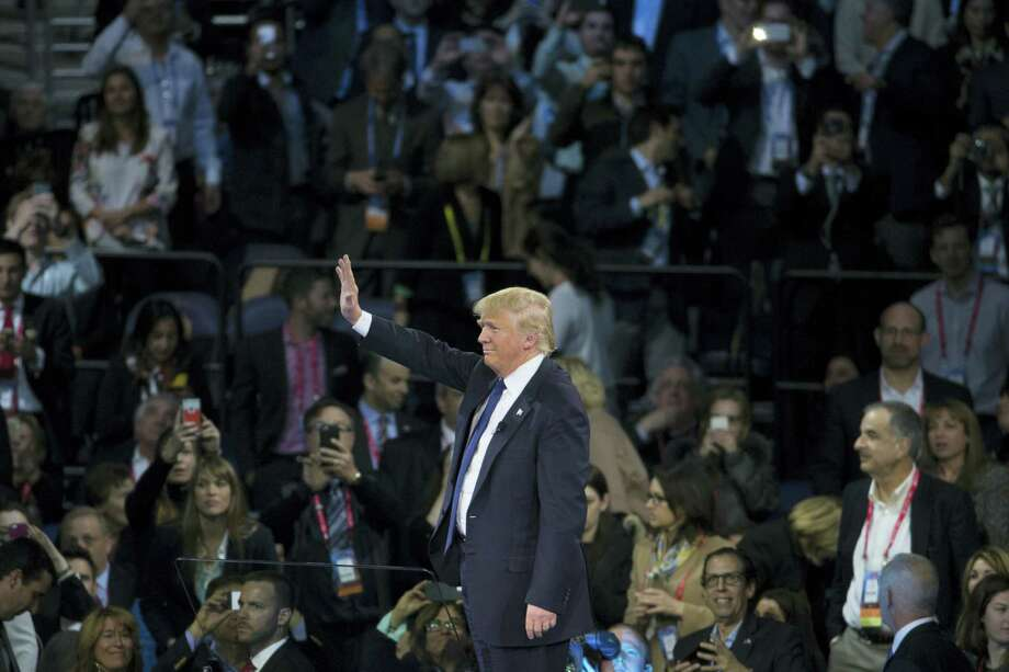 Republican presidential candidate Donald Trump waves as he arrives to speak at the 2016 American Israel Public Affairs Committee (AIPAC) Policy Conference at the Verizon Center on Monday in Washington. Photo: ASSOCIATED PRESS   / AP