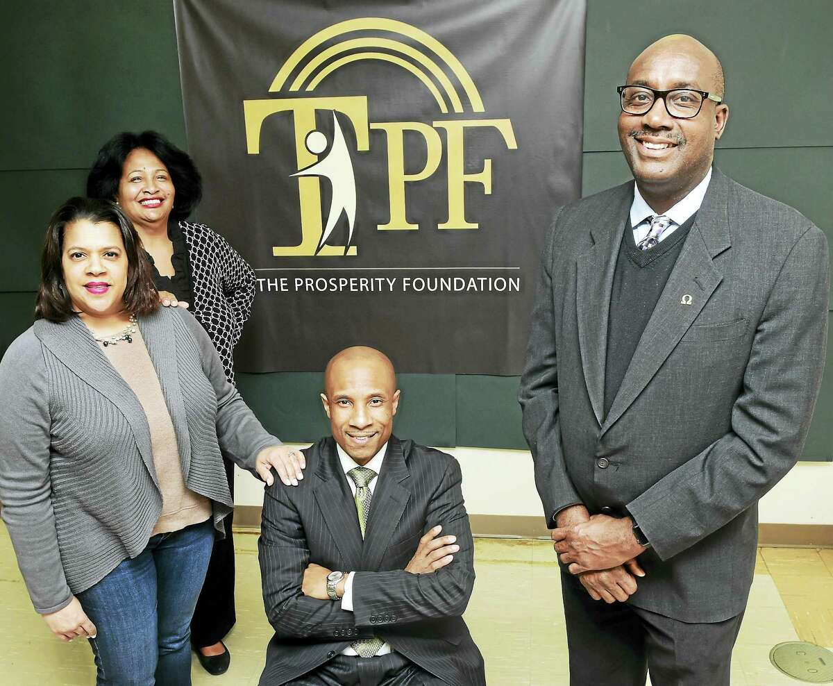 Board members of The Prosperity Foundation are, from left: Nancy Hill, secretary; Carolyn Vermont, board member; Howard K. Hill, President; and Larry Conaway, vice-president; at New Light School in New Haven Friday.