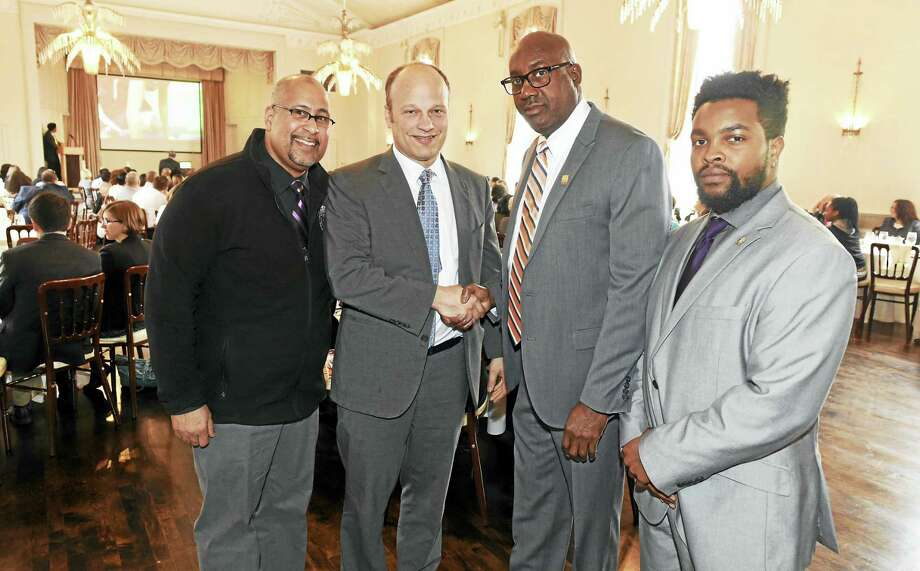 From left, Jason Bartlett, city youth services director; Superintendent of School Garth Harries; New Light High School Principal Larry Conaway; and Malcolm Welfare, leadership coordinator for the New Haven Public Schools, at The Great Escape Benefit Breakfast Wednesday at the New Haven Lawn Club. Photo: Peter Hvizdak — New Haven Register    / ©2016 Peter Hvizdak