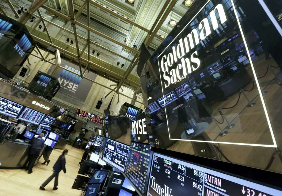 In this Aug. 15, 2014 photo, a lighted sign marks the Goldman Sachs trading post on the floor of the New York Stock Exchange. Photo: AP Photo/Richard Drew, File   / AP