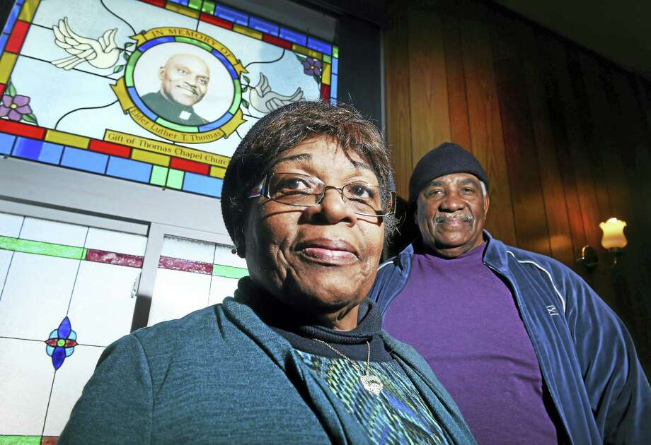 (Arnold Gold-New Haven Register)  Eldress Claudette E. Mays and Tommyjoe Battle stand next to a stained glass window with a portrait of founding Rev. Luther T. Thomas at Thomas Chapel Church of Christ D.O.C. on White Street in New Haven. Photo: Journal Register Co.