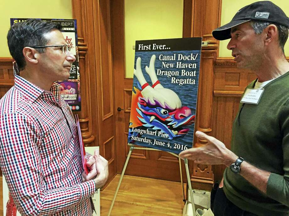 John Pescatore, president of Canal Dock Boathouse, right, chats with Anthony Lupinacci of the Shubert Theatre at the Wednesday press event. Photo: Joe Amarante — New Haven Register