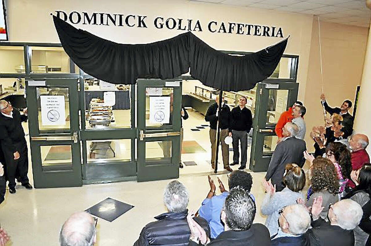 The sign is unveiled at the newly named Dominick Golia Cafeteria at Ansonia High School.