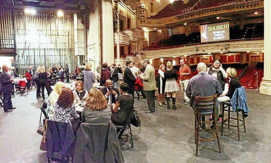 Staffers and media socialize on the Shubert Theatre stage before Wednesday night announcement of the new season. Photo: Joe Amarante — New Haven Register
