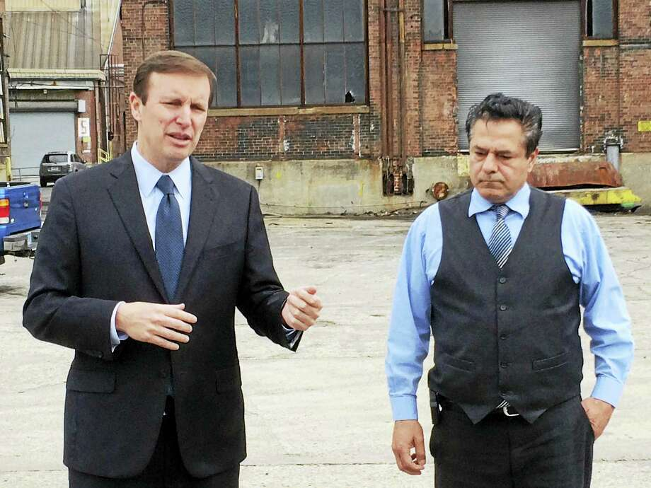 U.S. Sen. Chris Murphy, D-Conn., speaks to reporters Wednesday about cleaning up the former Ansonia Copper & Brass plant as Mayor David Cassetti looks on. Photo: LUTHER TURMELLE — NEW HAVEN REGISTER