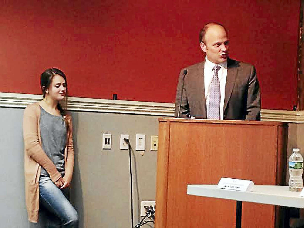 Superintendent of Schools Garth Harries speaks at a forum for the seven city sophomores seeking election to a two-year term on the Board of Education. The victor will replace senior Kimberly Sullivan, at left.