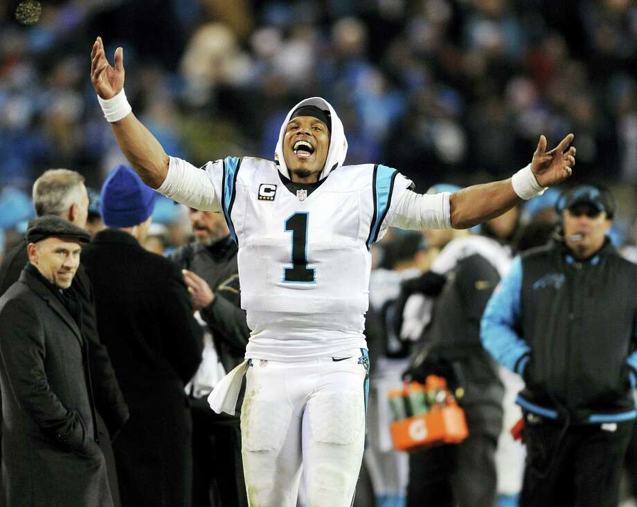 Cam Newton and the Panthers will face off against Peyton Manning and the Broncos in Super Bowl 50. Photo: The Associated Press File Photo   / FR34342 AP